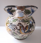 Faience jug with doves