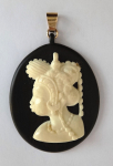 Cut medallion with a portrait of African women