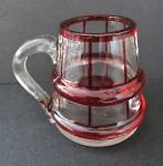 Small ruby glass jug