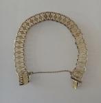 Fine gold bracelet with rhombus