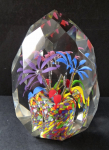 Paperweight in the shape of the crystal and three flowers