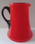 Red jug with black handle