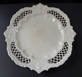 Stoneware plate, decorated with lattice and trim