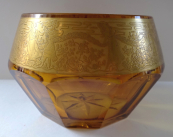 Bowl made of amber glass and gilded ornament