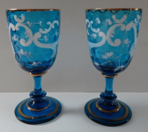 A pair of blue glasses with white leaves