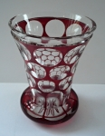 Cup with ruby glazing and cut lenses