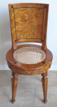 Classicist circular chair with caned seat