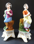 Figural pair of boy and girl on a pedestal