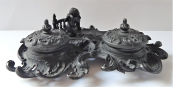 Cast iron inkwell with cherubs