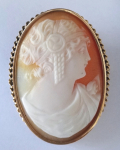 Golden brooch with cameo