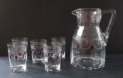 Pitcher with five glasses and a red lozenge