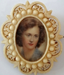 Miniature girls in ivory frame