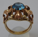Golden ring with light blue stone