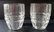 Two clear cask shaped glasses
