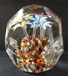 Paperweight with three colored flowers