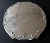Silver round powder compact without monogram