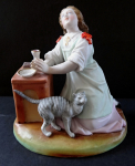 Kneeling girl with a cat