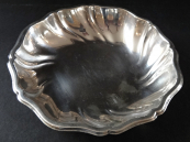 Silver bowl with curved edge