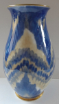 Porcelain vase with blue pleated pattern