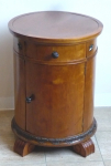 Round bedside table with a door and drawer