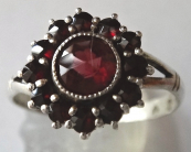 Silver ring with garnets and almandin