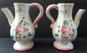Two small faience jugs with roses