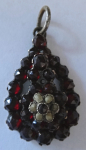 Pendant with garnets and river pearls