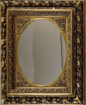 Oval mirror in a golden frame with laurel leaves