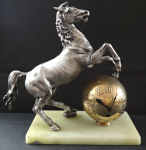 Table clock with statuette of a horse