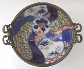 Japanese porcelain bowl with bronze rim