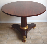 Empire mahogany table, with gilded lion paws