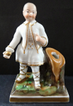 Figurine Chinese boy with a ball - stand