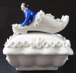 Man in a shoe, with white flowers - a box