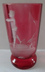 Pink glass with white boy figure