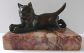 Bronze kitten with a ball - on  pedestal