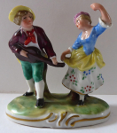Miniature sculpture of a young man with a guitar and dancing girl