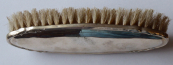 Brush for clothes with silver cover