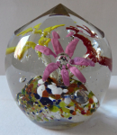 Round glass paperweight, with three flowers