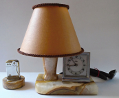 Table lamp, with clock and lighter