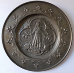 Tin decorative plate with the motif of the saint