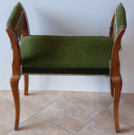 Chair with armrests and green upholstery