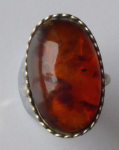 Ring of white metal, with amber