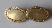 Gold cufflinks with silver carabine