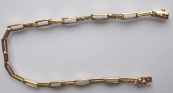 Gold bracelet with oval articles