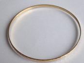 Gold bracelet, circle, with geometric ornament