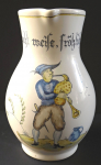 Wine mug, with a bagpiper and an inscription - Majolika Manufaktur Karlsruhe