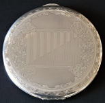 Silver round powder compact with engraved ornament