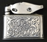 Silver lighter with engraved ornament