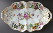 Decorative bowl and painted and embossed flowers and gilding