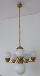 Chandelier made of polished brass and four arms